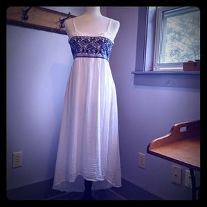Roxy backless dress with asymmetrical hem.